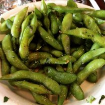 edamame with chili oil, cilantro, and sea salt