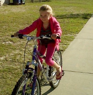 moo, age 7, on sissy's cool purple bike