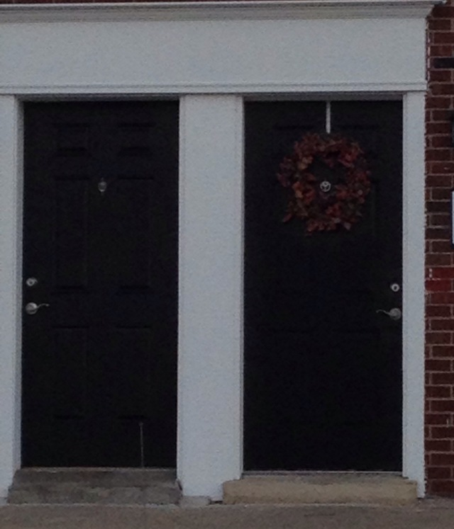 on nearby townhomes -- i like the way the wreath repeats the color of the brick