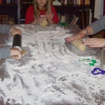 the girls preparing for sugar cookie dough